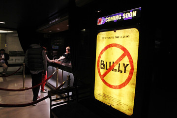 "People stand at the box office as a movie poster is seen for the documentary film ""Bully"" during it's Los Angeles premiere in Hollywood"