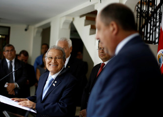 El Salvador's President Sanchez Ceren smiles as he listens to Costa Rica's President Solis during a news conference in San Jose, Costa Rica