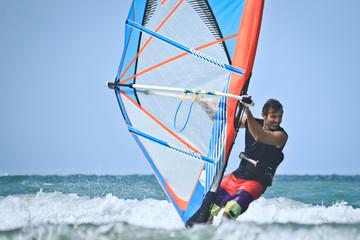 smiling happy windsurfer