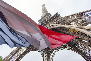 Eiffel Tower and French Flag, concept picture about political situation in France and terrorist attack