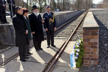 Rabbi Yitzhak Ehrenberg, new Israeli ambassador to Germany Hadas-Handelsman, his wife Ita and military attache Katz attend wreath-laying ceremony at the 'Gleis 17' (Platform 17) memorial