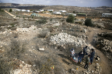 Israeli youths barbecue meat in the Jewish settlers' outpost of Amona in the West Bank