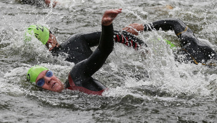 Zimbabwe's Christopher Felgate and Switzerland's Ruedi Wild compete in the men's triathlon final during the London 2012 Olympic Games at Hyde Park