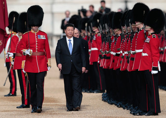 China's President Xi Jinping and Britain's Prince Philip review an honour guard during his official welcoming ceremony in London, Britain