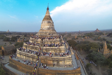 FILE PHOTO - People wait to see the sunset from the top of Shwesandaw Pagoda in the ancient city of Bagan