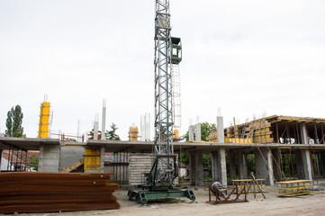 Construction Site. Crane at a Construction Site Against Blue Sky concrete blocks, armature