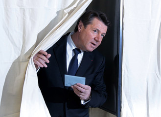 Christian Estrosi, mayor of Nice and Les Republicains political party candidate in the Provence-Alpes-Cote d'Azur (PACA) region, leaves the polling booth to cast his ballot in the second-round of the regional elections in Nice