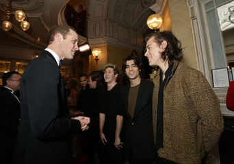 Britain's Prince William, the Duke of Cambridge, meets boy band One Direction in London