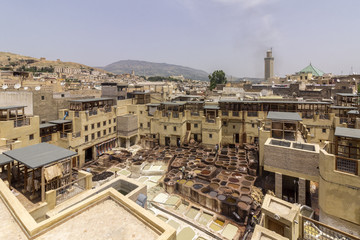 Fes el Bali city skyline and terrace view of the dye pots at leather traditional tanneries in the ancient medina, in Fez