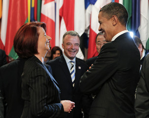 U.S. President Obama and Australia's PM Gillard smile during the second day of the NATO Summit in Lisbon