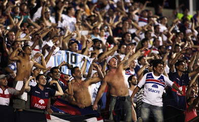 Fans of Argentina's Tigre cheer before their team plays Brazil's Sao Paulo in the Copa Sudamericana second leg final soccer match in Sao Paulo