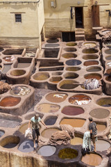 Fes el Bali worker the dye pots at leather traditional tanneries in the ancient medina, in Fez