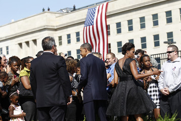 U.S. President Barack Obama and first lady Michelle Obama meet families of 9/11 victims at the Pentagon Memorial in Washington