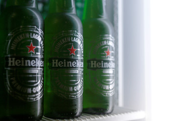 Botttles of Heineken lager beer are seen in a picture illustration inside a refrigerator in Vienna