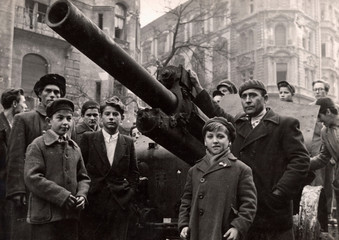 Fighters stand next to a Soviet tank on the streets of Budapest at the time of the uprising against the Soviet-supported Hungarian communist regime in 1956