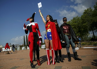 Participants wearing superhero costumes attend the World DC Comics Super Heroes event in San Martin de Valdeiglesias, near Madrid