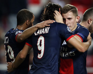 Paris St Germain's Cavani is congrtulated by his team mates Lucas and Digne after scoring a goal against Benfica during their Champions League soccer match in Lisbon