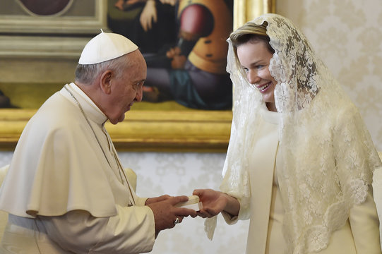 Pope Francis gives a gift to Belgium's Queen Mathilde during a meeting at the Vatican