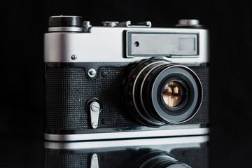 Vintage camera on a black