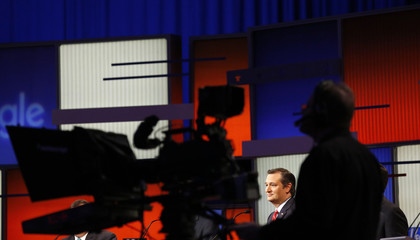 Republican U.S. presidential candidate Ted Cruz is framed in the silhouette of a television camera during the debate held by Fox News for the top 2016 U.S. Republican presidential candidates in Des Moines