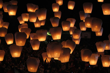 People release sky lanterns ahead of the traditional Chinese Lantern Festival in Pingxi