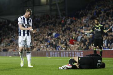 West Bromwich Albion's Chris Brunt applauds Chelsea's Eden Hazard after he wins a free kick