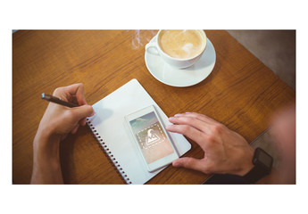 Phone and Notebook User at Coffee Shop Mockup