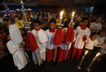 Sacristans wait for the procession to celebrate the Feast of the Resurrection to begin on Easter Sunday