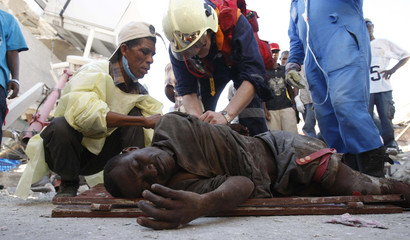 Rescuers provide medical aid to a man named Perst, 35, a victim of the earthquake in Haiti, in the capital Port-au-Prince