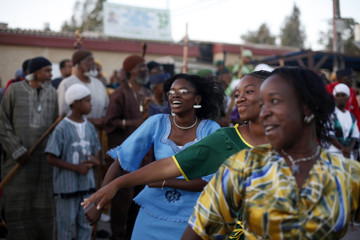 """Members of the African Hebrew Israelite community, popularly known as """"the Black Hebrews"""", dance as they take part in their celebrations for the holiday of Shavuot, in the southern town of Dimona"""
