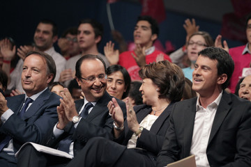 France's Senate Speaker Bel and France's Socialist Party's presidential candidate Hollande applaud during the Socialist party nomination ceremony in Paris