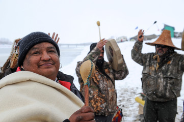 Men play traditional musical instruments in the Oceti Sakowin camp during a protest against plans to pass the Dakota Access pipeline near the Standing Rock Indian Reservation, near Cannon Ball, North Dakota, U.S.