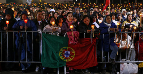 Faithful hold candles during the blessing of the candles ceremony led by Pope Francis from the Chapel of the Apparitions at the Shrine of Our Lady of Fatima in Portugal