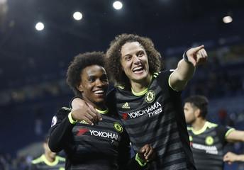 Chelsea's Willian and David Luiz celebrate winning the Premier League title
