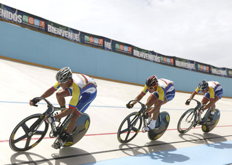 Venezuela's Cesar Marcano, Angel Pulgar and Hersony Canelon compete in the men's Team Sprint final at the Central American and Caribbean Games in Aguadilla