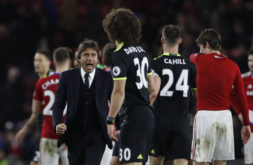 Chelsea manager Antonio Conte celebrates after the game with David Luiz and Gary Cahill