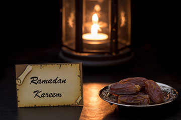 Ramadan kareem card with dates and lantern