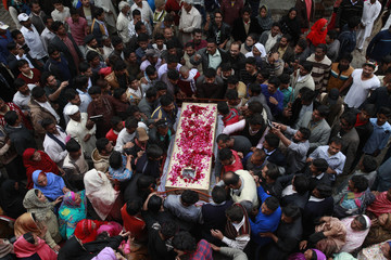 Christians carry the coffin of Zahid Yousaf, one of the victims killed by a suicide attack on a church, during his funeral in Lahore