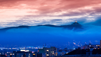 Illuminated Jested transmitter tower and hotel. Blue cloudy evening in Liberec, Czech Republic.