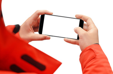 Man in red jacket holding smartphone in hands in horizontal position, isolated on white background