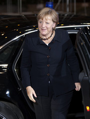 Germany's Chancellor Merkel arrives for a meeting at the European Council headquarters in Brussels