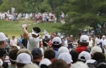 Y.E. Yang tees off on the fourth hole during the final round of the 2011 U.S. Open in Maryland