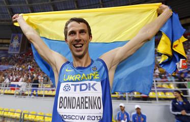 Bondarenko of Ukraine celebrates winning gold medal in the men's high jump final during the IAAF World Athletics Championships at the Luzhniki stadium in Moscow