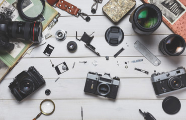 Broken film camera component repair and maintenance of photographic equipment concept. Flat lay