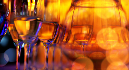 The order of wine glasses on an amber background