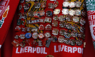 Badges are seen on a Liverpool fan before their English FA Cup semi-final soccer match against Everton at Wembley Stadium in London