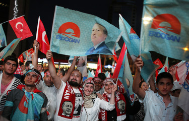 Supporters of Turkey's PM Erdogan celebrate his election victory in front of the party headquarters in Ankara