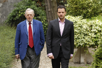 Jerome Kerviel, former junior trader at French bank Societe Generale, walks with his French lawyer Metzner during an interview with Reuters