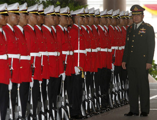 Chief of the Royal Thai Army Gen. Chan-ocha stands near a row of honour guards in Bangkok