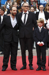 Cast members Fuith and Rauchenberger pose with director Schleinzer as they arrive on the red carpet for the screening of the film Michael in competition at the 64th Cannes Film Festival